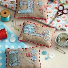 Cross stitch pin cushions: