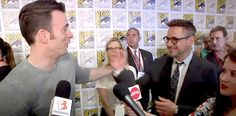 Robert Downey Jr. kisses and hugs Chris Evans in the middle of an interview.