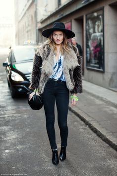 fur jacket, wide-brim hat, and high-waisted jeans