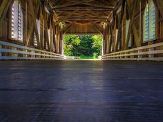 A shot looking out of Dorena Bridge in Cottage Grove, Oregon. Cottage Grove is home to seven covered bridges.   To see more of my work go to www.michelejamesphotography.com or visit me on Twitter (@micheleyjames) or my Facebook Fanpage Michele James Photography.