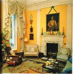 Evangeline Bruce's London drawingroom by John Fowler.....apricot walls,extravagant oyster curtains,chocolate velvet and gingham all anchored by the exqusite rug....Mr Fowler never surpassed this tour de force