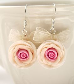 Earrings of pink and beige hand sculpted polymer clay roses.    These earrings are a part of spring/summer collection and is inspired by cherry blossoms. These roses are tender and a dream for every princess.  Metal parts of the pieces are a color of silver. Three different colors were mixed together to make every rose get the most natural look. After that, the polymer clay was sculpted into roses, petal by petal.  Diameter of the rose is 1,7cm/ 0.7 inches.