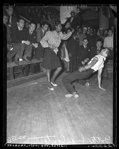 Crowd watching a couple dance in Jitterbug Dance contest Los Angeles, Calif., 1939  Publication: Los Angeles Daily News  Publication date: 1939