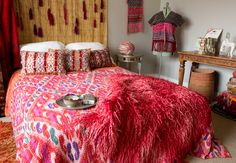 ooo la la..colorful home decor! red ikat, bedding, berber pillows and red tulu rug www.loadedtrunk.com