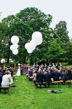 Jumbo white balloons and bench seating - Classic English-countryside Wedding Ideas (BridesMagazine.co.uk)