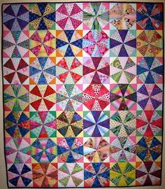 Kaleidoscope quilt I love scrap quilts, they seem to shine so much better than ones made of only a couple fabrics. Scrappy Quilts, Baby Quilts, Quilting Projects, Quilting Designs, Quilting Ideas, Winding Ways Quilt, Kaleidoscope Quilt, Quilt Modernen, Fabric Art
