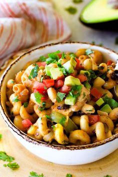 Lighter ONE POT Chicken Fajita Pasta smothered in cheesy, creamy salsa infused sauce bursting with your favorite fajita spiced chicken, onions and peppers!