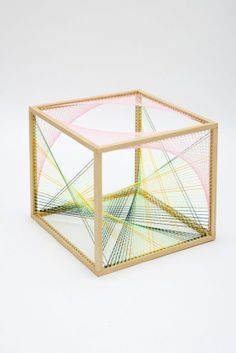 Sliding Ladder by Nike Savvas    Snap, snap, snap, snap…five, six, seven, eight. Presenting a mathematic beat featuring threads bound into beautiful bursts by Nike Savvas. A collaboration of wooden outlined hexagons create a unique take on the soccer ball pleasing in pink, yellow, teal, and ...