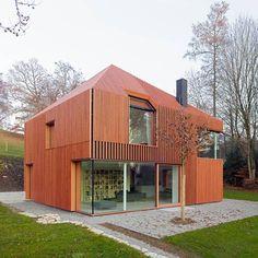 House 11×11 by  Titus Bernhard Architekten. Crazy design..wonder if it's dark inside?