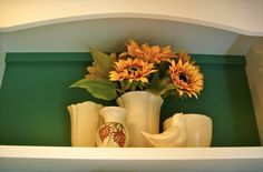 Vintage White McCoy Pottery makes a striking display against a colored wall. ~ Mary Walds Place -   white pottery collection