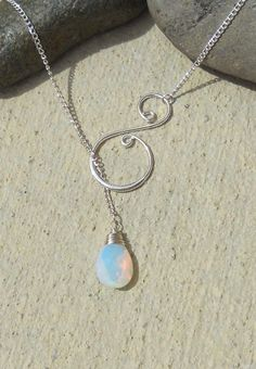 Silver wire wrapped gem with swirl, lariat necklace - 15 gems to choose from, handmade jewelry. $19.75, via Etsy.