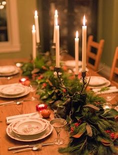 A green garland filled with winter greens, red berries and feathers is a great alternative centerpiece!  It's low to the table so you can see all of your guest!  Just tuck in your favorite candle sticks to finish the look!  Made in Baltimore by Local Color Flowers.