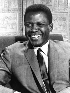 Sidney Poitier born 1927. Movie actor.  First black man to win an academy award for best actor.