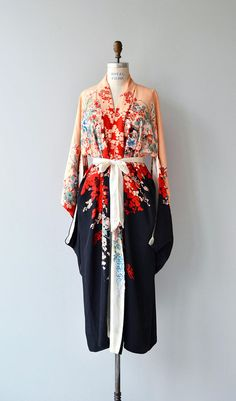 Rare vintage 1920s reversible silk kimono in very unique colorway. A black and peach floral moody side contrasts a serene pale and pastel floral reverse side. Long silk sash belt.  ✂-----Measurements  fits like: free size bust: free waist: free length: 52 brand/maker: n/a condition: excellent  ✩ layaway is available for this item  to ensure a good fit, please read the sizing guide: http://www.etsy.com/shop/DearGolden/policy  ✩ visit the shop ✩ http:/&#x...