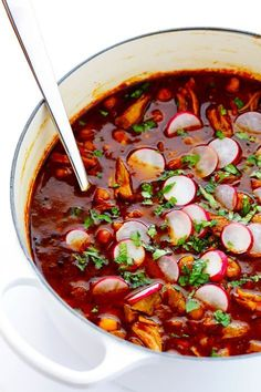 This Posole Rojo recipe is a delicious Mexican pork stew, slow simmered with the most amazing chiles. | gimmesomeoven.com