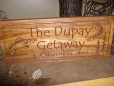 Our stained wooden carved personalized welcome sign with pine trees, Walleye and Northern Pike is a classic rustic traditional style and