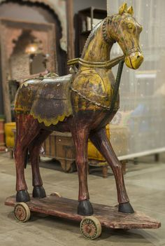 Century Carved Wooden Horse / With poly-chrome paint finish and painted details. Originally used as decorative sculptures in ceremonies and festivals by tribes from Rajasthan.