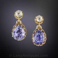 Dating back to the-turn-of-the-twentieth-century, a fabulous pair of ear drops featuring a matched pair of natural no-heat Ceylon sapphires, together weighing 6.20 carats, imbued with a deeply saturated, vibrant, violet-blue hue. The gorgeous pear shape gemstones are displayed in 18K rosy-yellow gold coronet settings and swing, sway and sparkle below a matched pair of bright-white old mine-cut diamonds. Splendid! 3/4 inch long and extraordinarily lovely.