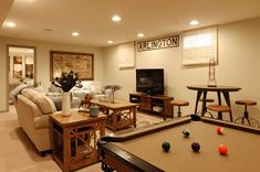 small basement ideas family room pool table sofa wooden side tables