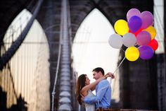 NYC Engagement Photos on the Brooklyn Bridge with Balloons as props