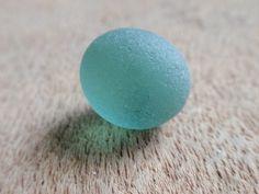 Absolutely stunning aqua, perfectly round JQ Eglish sea glass gem