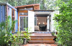 The Savannah Project by Price Street Projects in Savannah, Georgia, USA. As a port city, Savannah has an abundance of obsolete shipping containers. Artist Julio Garcia repurposed two of these containers to create his residence and studio in Savannah. Building A Container Home, Container Cabin, Container Buildings, Container Architecture, Container Design, Cargo Container, Sustainable Architecture, Sustainable Houses, Container Garden