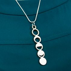 Stylishness will never wane in this out-of-this-world necklace! Stainless steel 6.5cm moon phase necklace on a black cord. Available in various colors.