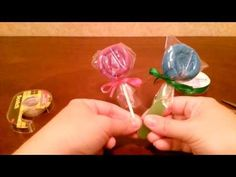 How to make a Washcloth Lollipop DIY (Tutorial) by shopbgd.com - YouTube (wonder if we could do this on a bigger scale with baby blankets?)