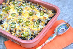 Mexican casserole: salsa, beans, ground turkey, rice, cheese. Easy and delicious!