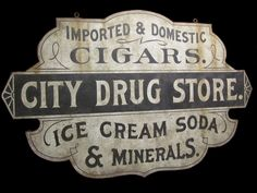 My reproduction of a late century drug store sign.
