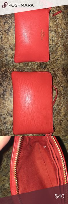 ORANGE/RED COACH WRISTLET !! this small coach wristlet can be worn as a small around the wrist bag for going out! It can also be used as a wallet in your big bag! Brand new and in perfect condition. Perfect accessory when you don't want to carry around a big bag. It is 100 percent authentic Coach Bags Clutches & Wristlets