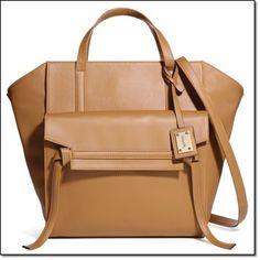 "mark. NEUTRAL TERRITORY BAG • Faux leather with shiny goldtone hardware • Zippered top closure • 1 outside flap pocket with magnetic snap closure; 1 exterior slip pocket in back; 3 interior pockets (2 slip pockets at front; 1 zippered pocket at back) • 18"" W x 13 1/2"" H x 5"" D (4"" handle drop; 25"" L max detachable, adjustable strap) http://jgoertzen.avonrepresentative.com/"