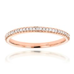 This Slim Stackable Diamond Ring in 14K gold showcases 0.18 carats of sparkling round diamonds. Featuring a lovely design and a highly polished gold finish, this ladies diamond ring is available in 14K white, yellow and rose gold. Please note: this listing is for 1 ring only.