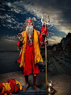 Varanasi, India - Wandering Holy man: He carries a trident has metal rings on it that make a loud jingling sound which is used to announce his arrival at a village. Varanasi, Namaste, Amazing India, Bhutan, Durga, World Cultures, People Around The World, Belle Photo, Nepal
