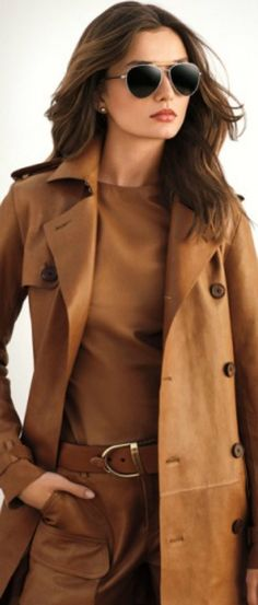 True Autumn. Dark Autumn could certainly wear this, an expensive-looking monochromatic, but she might find the lipstick too flesh-toned and prefer a darker, bronzier, or red rust colour. With this kind of off-the-charts cool, are we looking at Yang Natural?