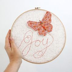 """Embroidery Hoop - Joy Flutters In - hand embroidered butterfly 10"""" wall hanging in peach, pink, beige, white, and lilac"""