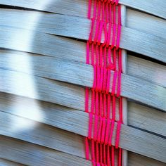 (neon weaving on wood)