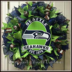 Seattle Seahawks deco mesh wreath by Twentycoats Wreath Creations Seattle Seahwks, Creative Gift Packaging, Superbowl Champs, Christmas Diy, Christmas Decorations, Mesh Wreath Tutorial, Sports Wreaths, Football Wreath, Sports Decor