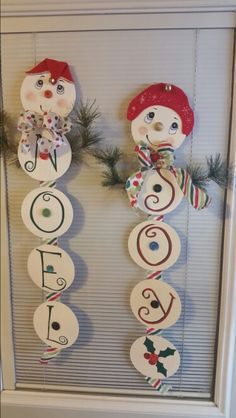 These are my little snowmen I made from old cds and old buttons.