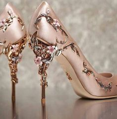 I have never liked stilletto heels...but these are such works of art! I guess I would just admire them on a shelf?