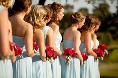 pale blue maids carrying red roses and dahlias. Need orange in the florals...