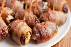 "Bacon-wrapped dates might not win a beauty pageant, but trust me, they will disappear from the buffet spread before you can say, ""Come on in."" The combination of salty, crispy bacon with sugar-sweet … Fancy Appetizers, Bacon Appetizers, Appetizer Recipes, Appetizer Dips, Snack Recipes, Bacon Dates, Bacon Wrapped Dates, Antipasto, How To Make Bacon"