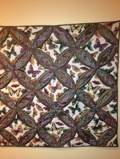 My Butterfly Cathedral Window quilt