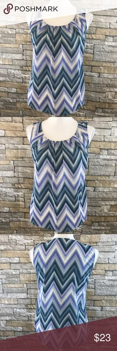 """Chico's Multicolor Chevron Sleeveless Tank Size 0 Love this beauty from Chico's. Chevron Print throughout in Multicolored Blue, Purple and white. Materials 94% Polyester, 6% Spandex.    Size 0. US equivalent 4    Measurements (laid flat) Armpit to armpit 17.5"""". Waist 17.5"""" Length 24"""" from top of shoulder   Condition Excellent condition pre-owned. No flaws noted.  T2 Chico's Tops Blouses"""