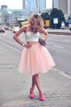Pint tulle skirt with white crop top and fuscia pointed shoes.