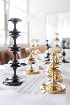 Stayman candlestick holders have the most lovely silhouette, don't you think? Made by @remainslighting with stackable, solid brass forms. Shown here in polished brass and an oil rubbed bronze patina.