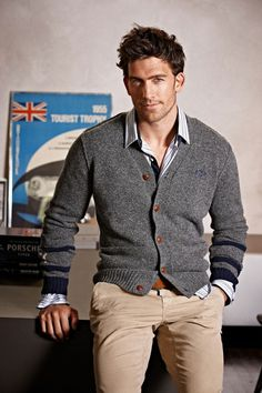 Classic style for men, neutral chinos worn with striped shirt and grey cardigan