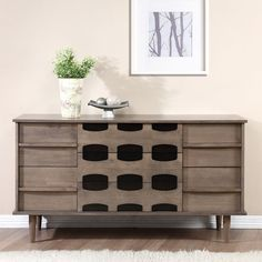 Instantly update any space with the refreshingly unique style of the Vanda seven-drawer dresser. The integrated pulls allow this mid century style piece to remain minimal while the rustic finishes tie it to traditional decor.