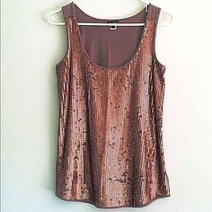 Sequined taupe tank top Taupe tank top by Eddie Bauer. Front is covered with rose gold sequins. Only been worn a couple times. I accept offers and bundles. Eddie Bauer Tops Tank Tops