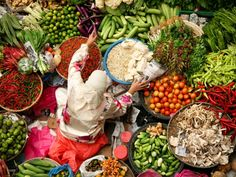 The town of Kota Bharu, located on the east coast of peninsular Malaysia, is home to many museums, mosques, and the famous Siti Khadijah Market, where local women gather to sell produce and snacks, like noodle soup and kuih (a type of Malaysian cookie).